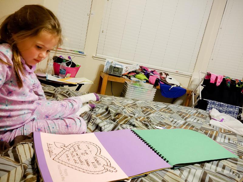 Looking Through her Kinder Memory Book